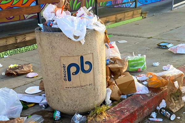 Overflowing trash receptacle